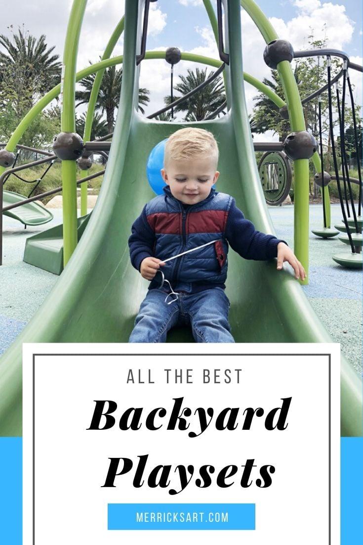 boy at the park sliding down the slide