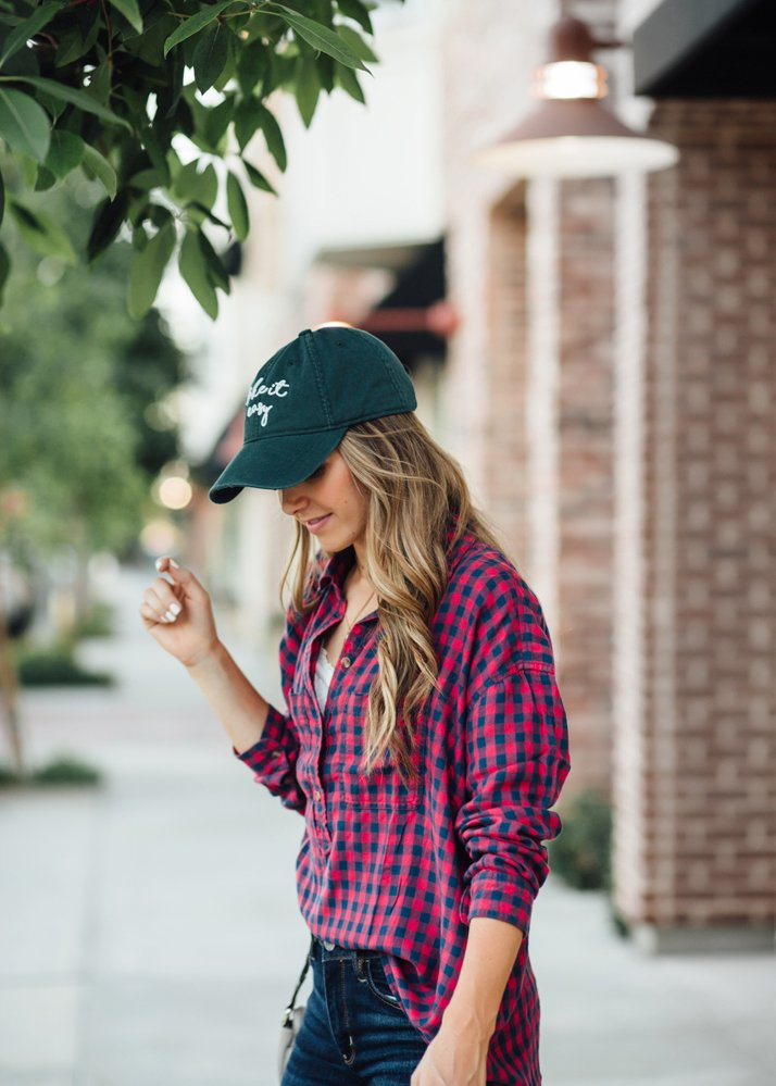 baseball hat and plaid top