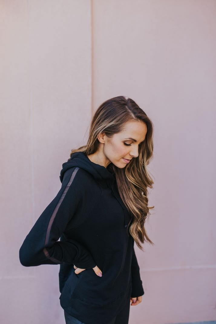black sweatshirt with mesh strip down the sleeve