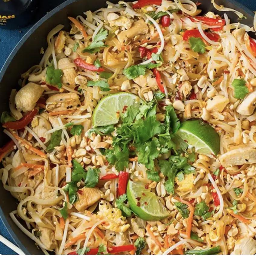 chicken pad thai in a wok