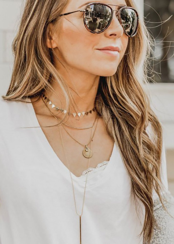layered necklace and sunglasses