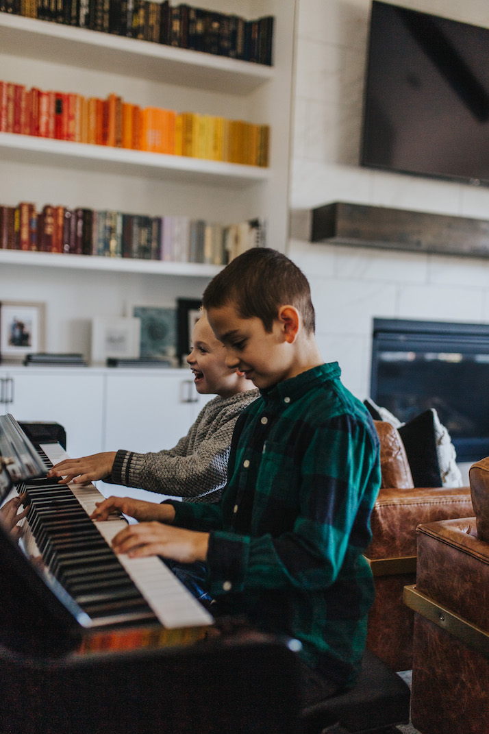 boys playing the piano