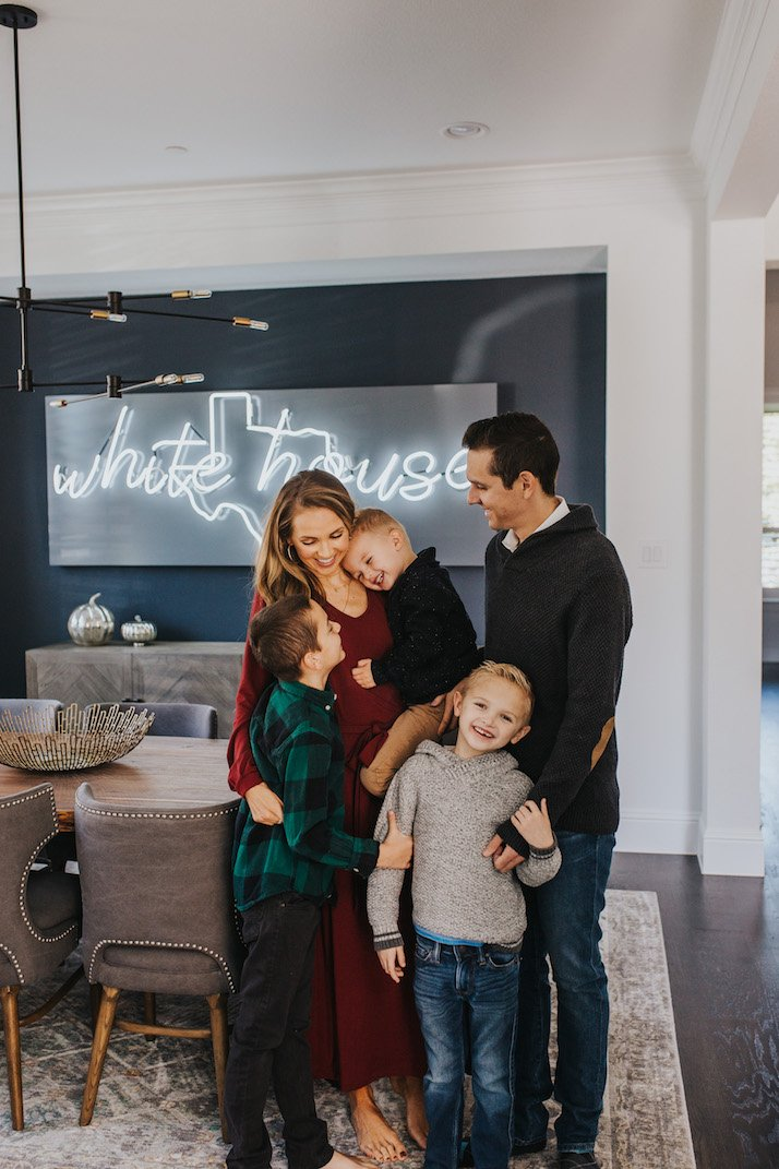 family in dining room with neon light