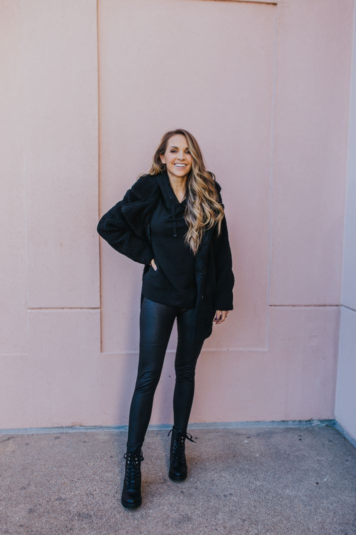 pink wall black outfit with combat boots