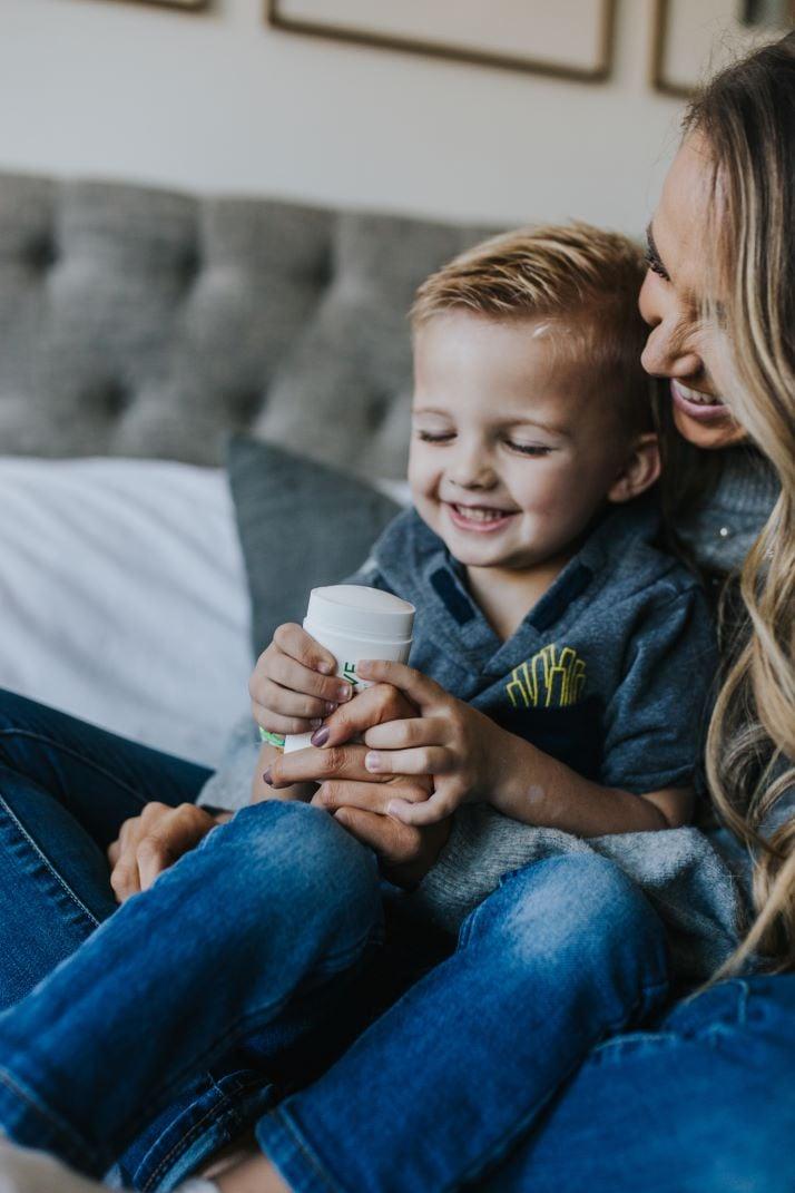 boy smiling mom holding native deodorant