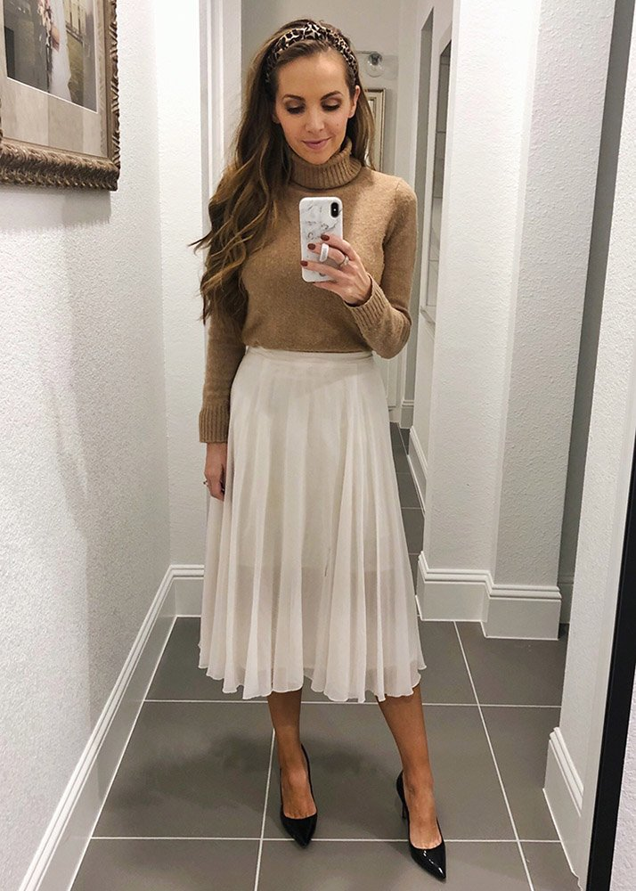 turtleneck and headband with white pleated midi skirt