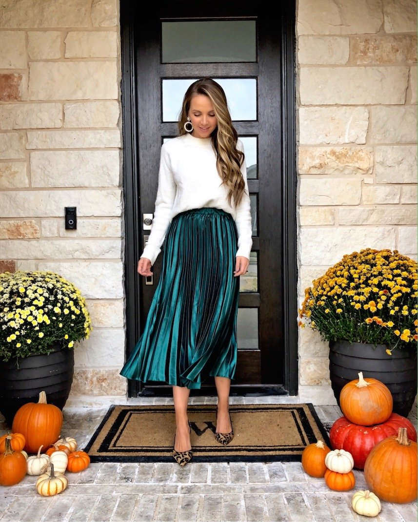 front porch with mums and pumpkins pleated green skirt white sweater