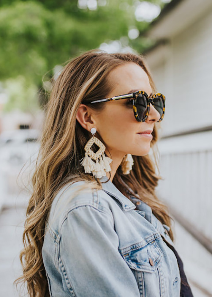 denim jacket and statement earrings