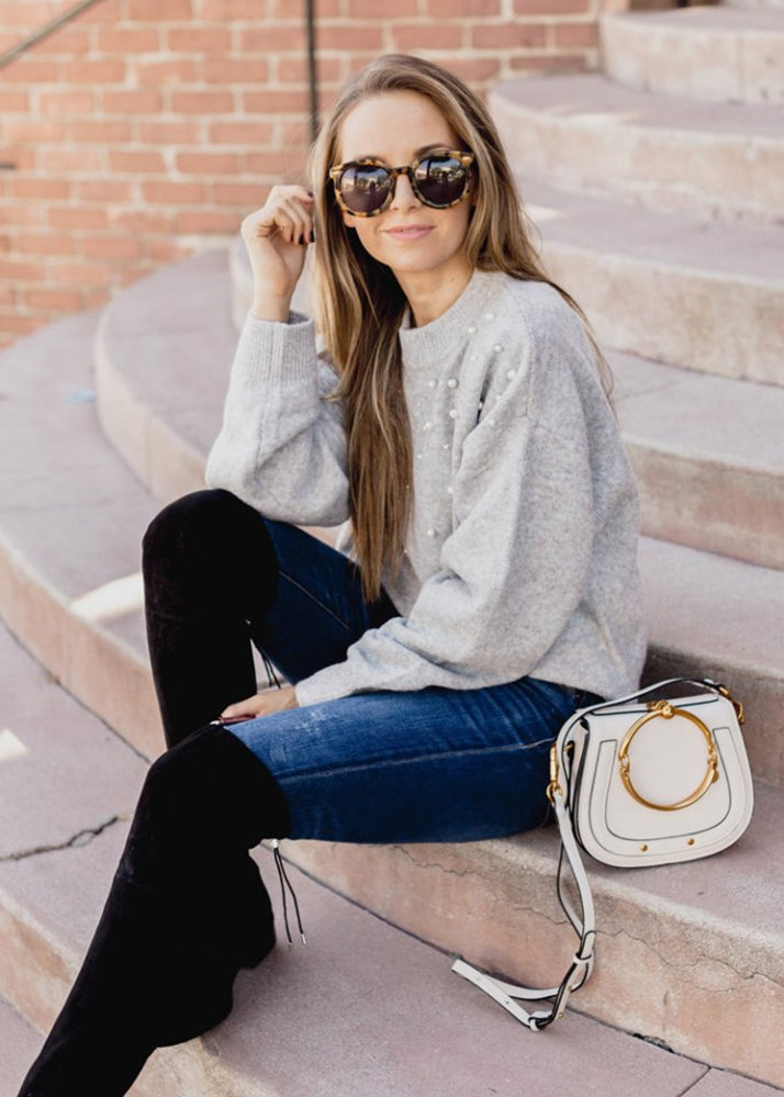 tortoiseshell sunglasses and gray sweater