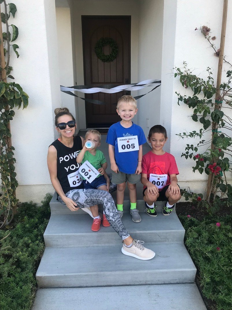 boys and mom on front porch for family turkey trot