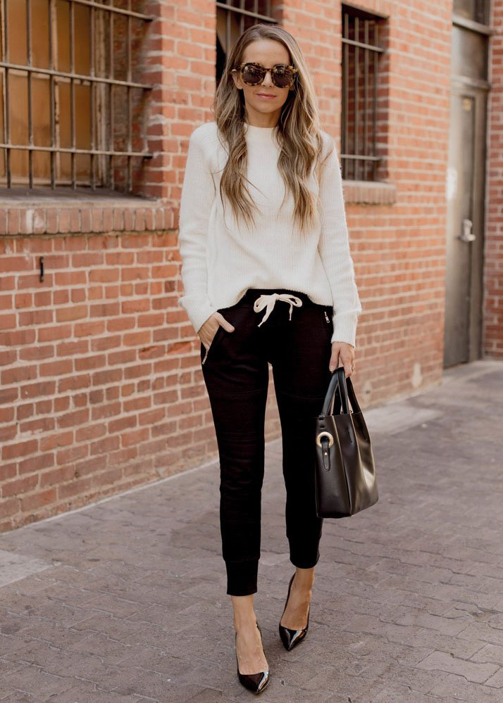 black joggers heels and a sweater