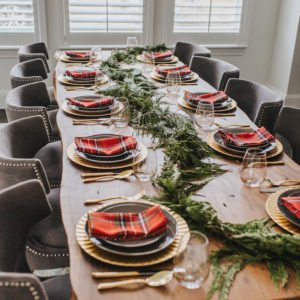 live edge table with gray and gold table setting with red plaid napkins