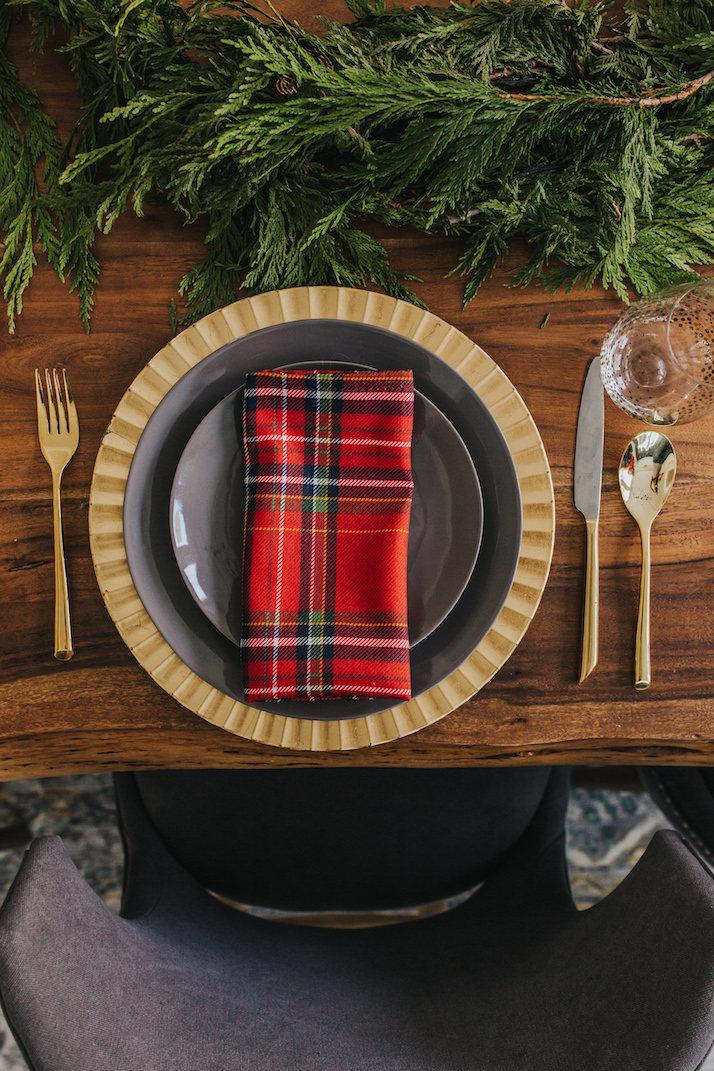 red plaid napkins, gold charger, gray table setting