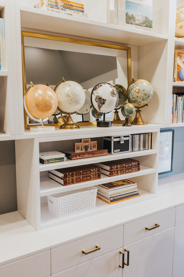 built in shelves with globe collection