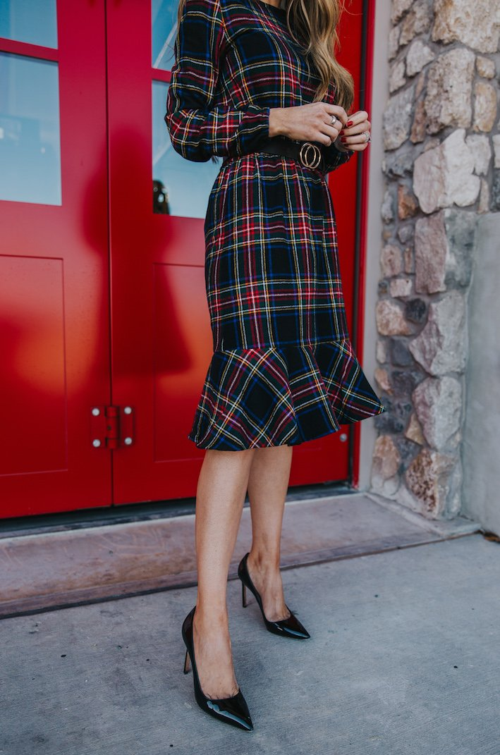 plaid dress with ruffle hem and black pointed pumps