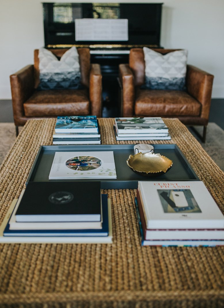 coffee table books and wicker coffee table