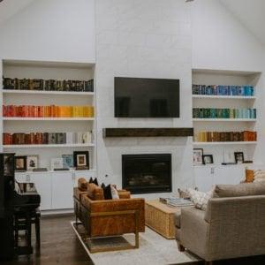 rainbow bookshelf and fireplace