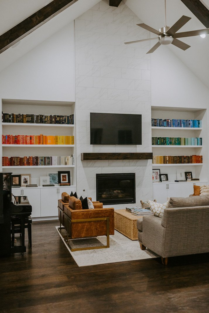 rainbow bookshelf and fireplace