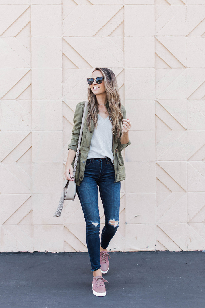 Olive utility jacket and gray t-shirt and jeans