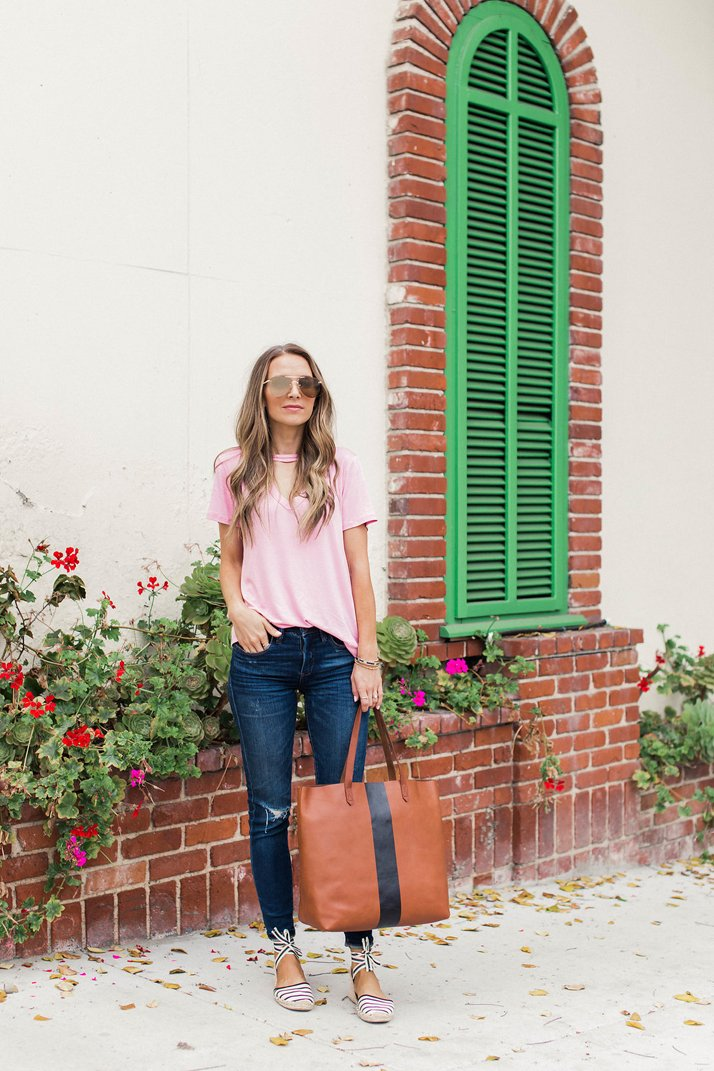 pink t-shirt and jeans