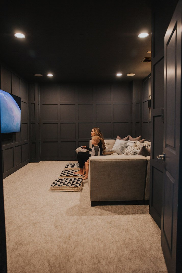 home theater room with wall paneling