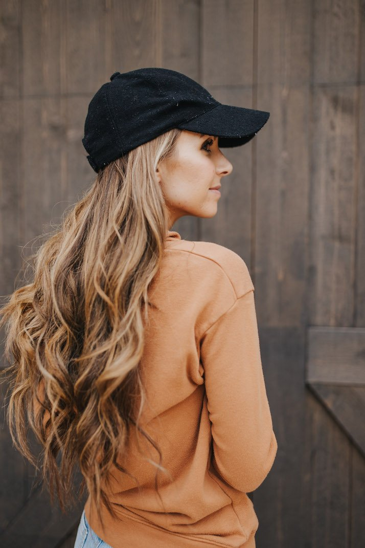 black baseball cap with sweater