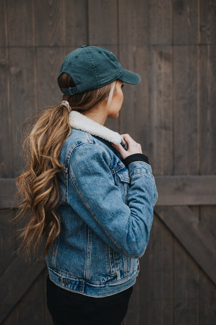 curled ponytail with shearling jacket