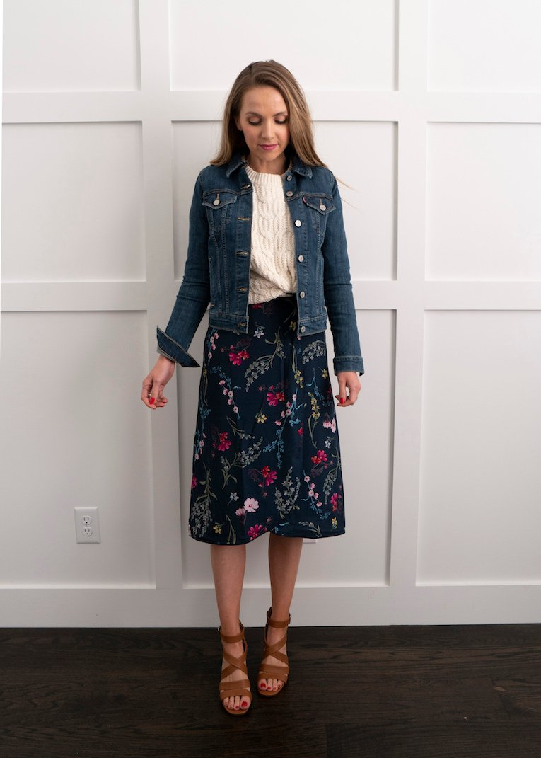 cable knit sweater with floral dress and denim jacket