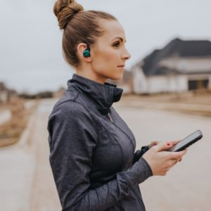 gray nike running jacket plantronics headphones