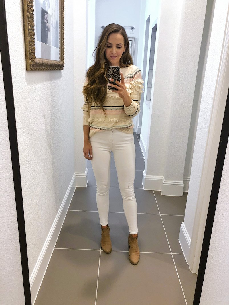 white jeans with loft fringe sweater