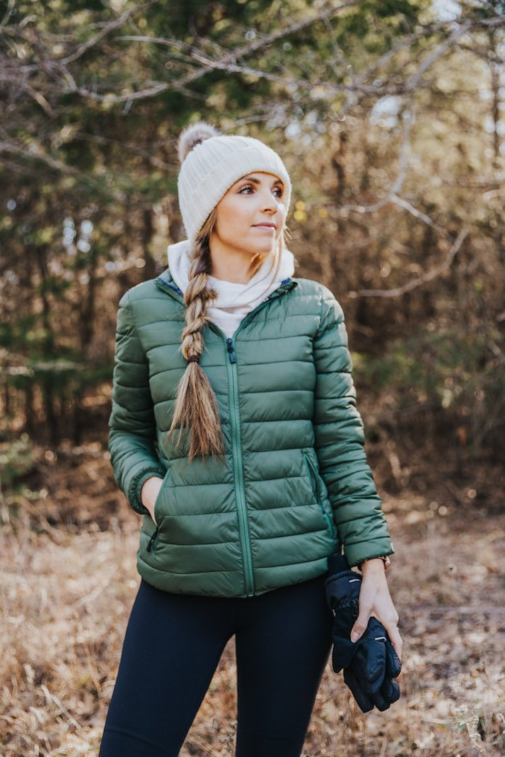 green puffer jacket running
