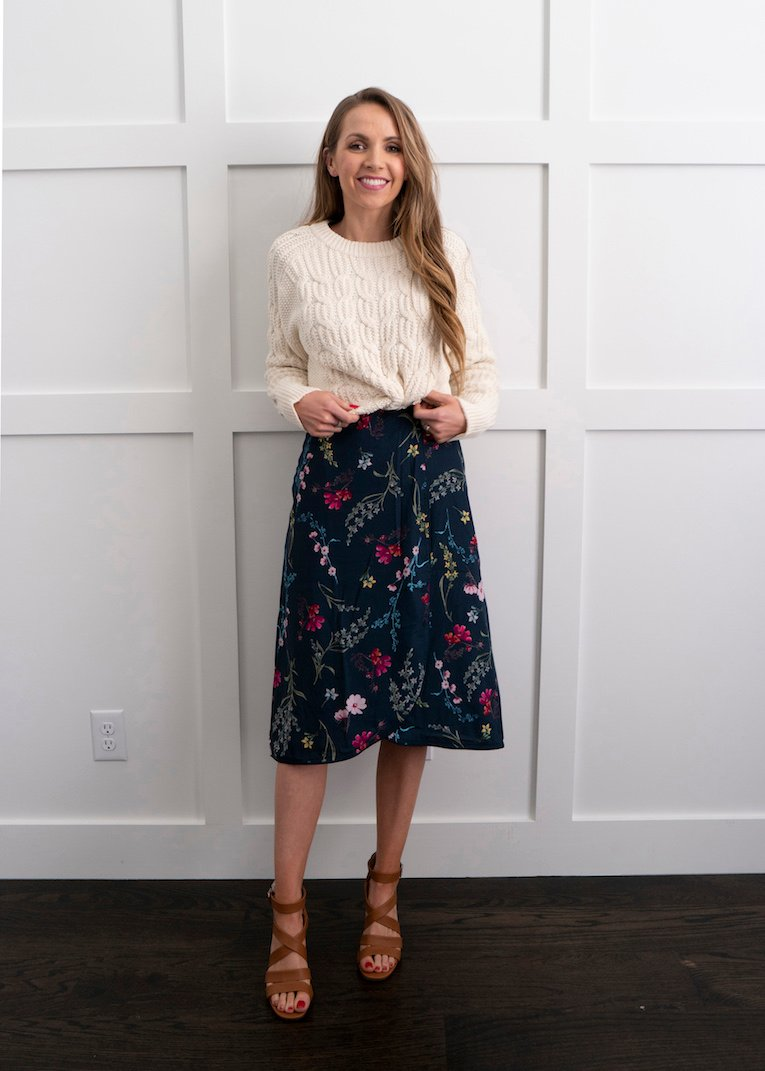 cable knit sweater with floral dress