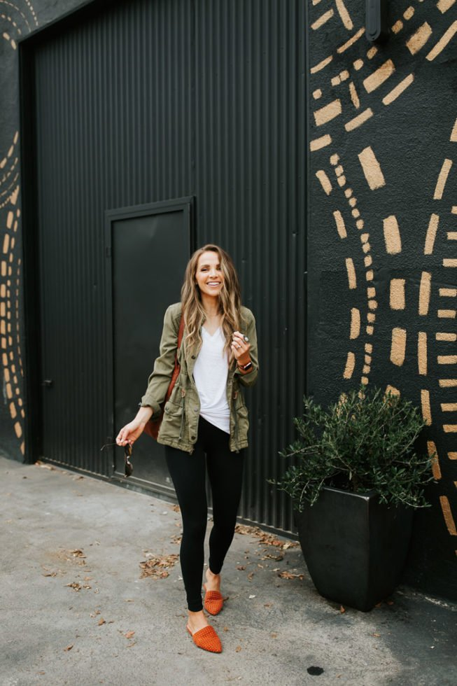 olive utility jacket and black leggings