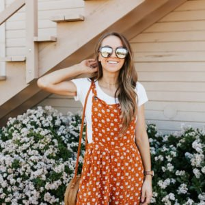 orange jumpsuit and quay sunglasses