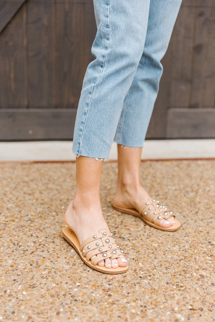 studded sandals and light wash jeans