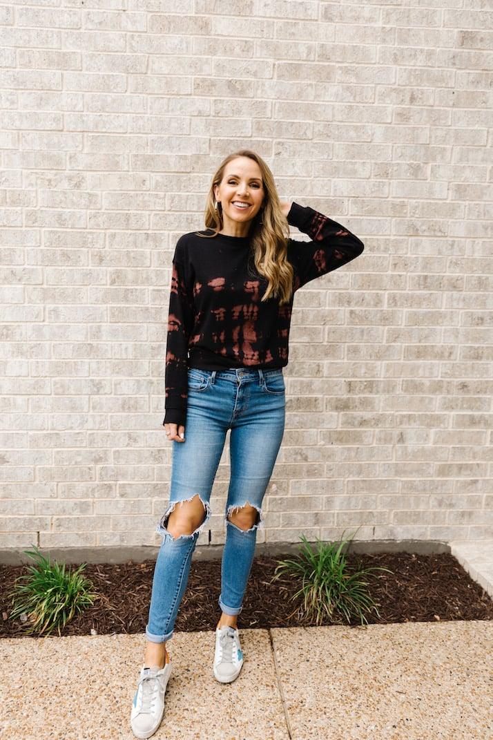jeans and bleach tie dye sweatshirt