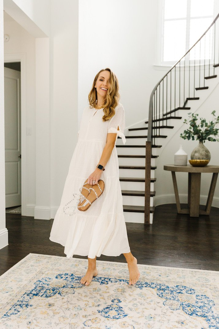 white dress with curved staircase