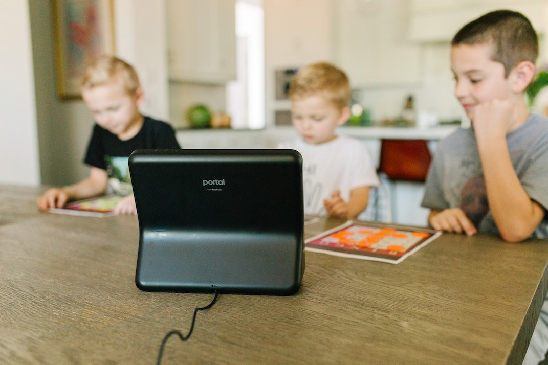 boys at kitchen table with facebook portal