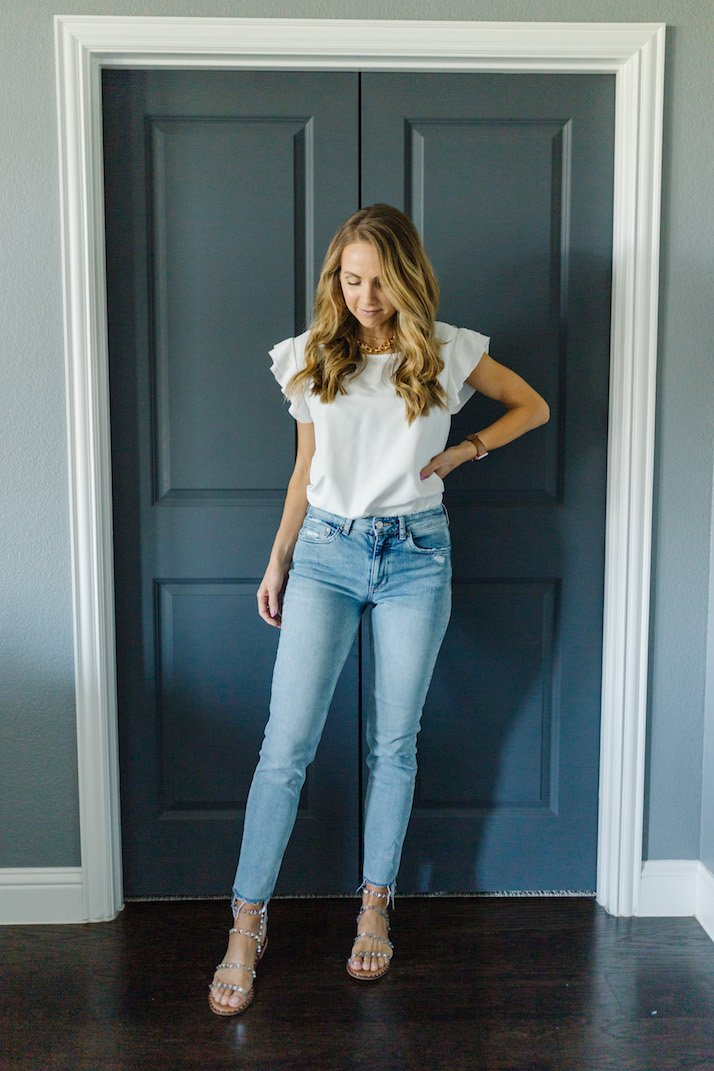 light wash jeans with white ruffle top
