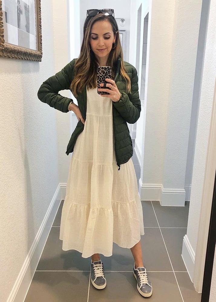 white dress and olive jacket