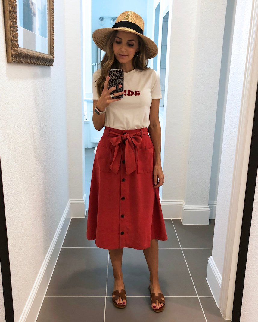 graphic tee with belted midi skirt