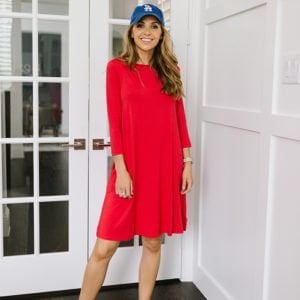 red swing dress and baseball hat