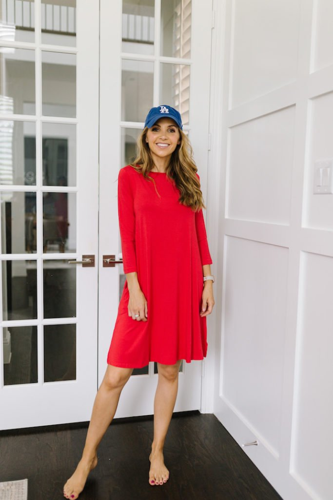 red dress with blue baseball cap