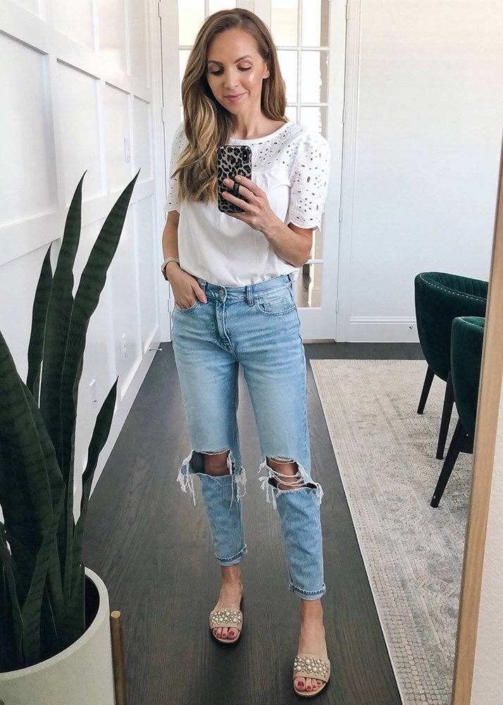 white eyelet top and mom jeans