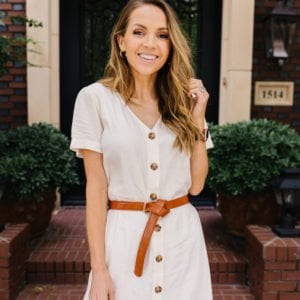 white dress with brown leather belt