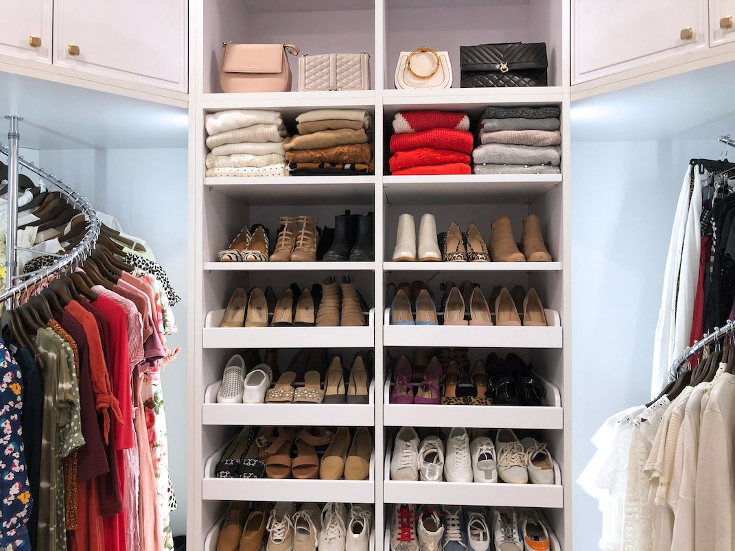 women's closet with shoe wall