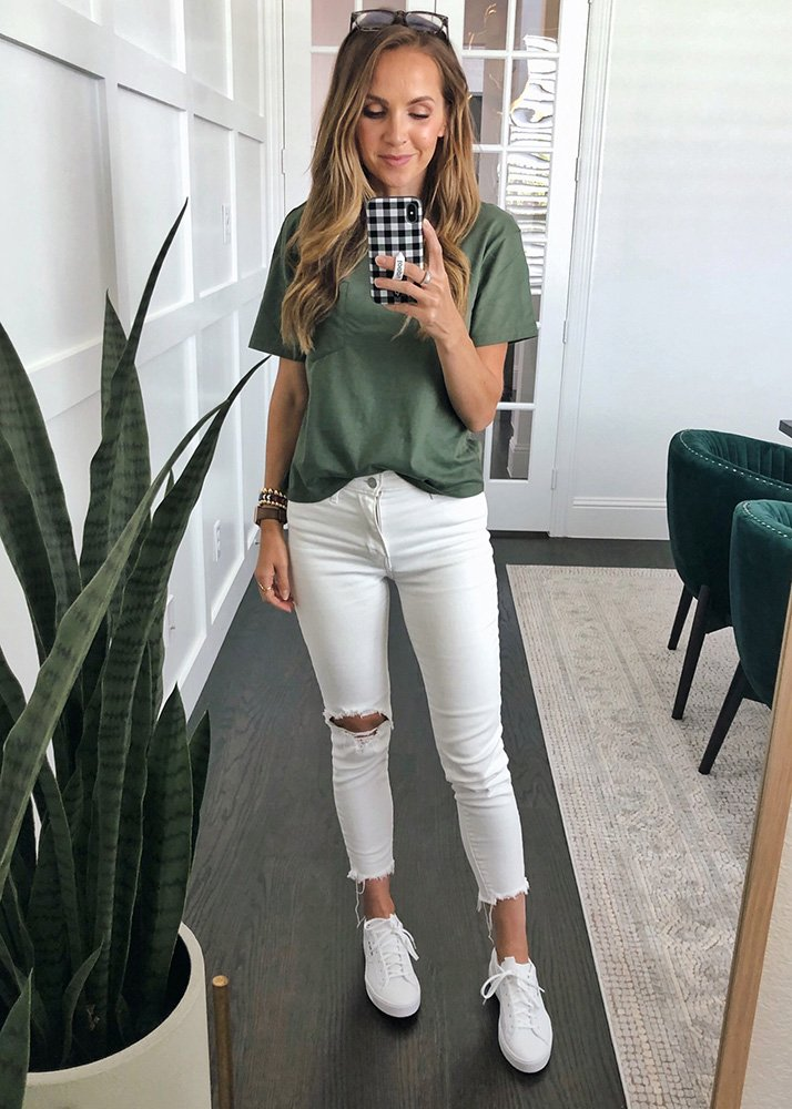 olive t-shirt and white jeans