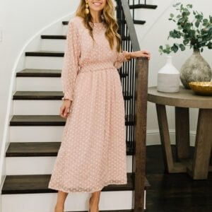polka dot blush dress on the staircase