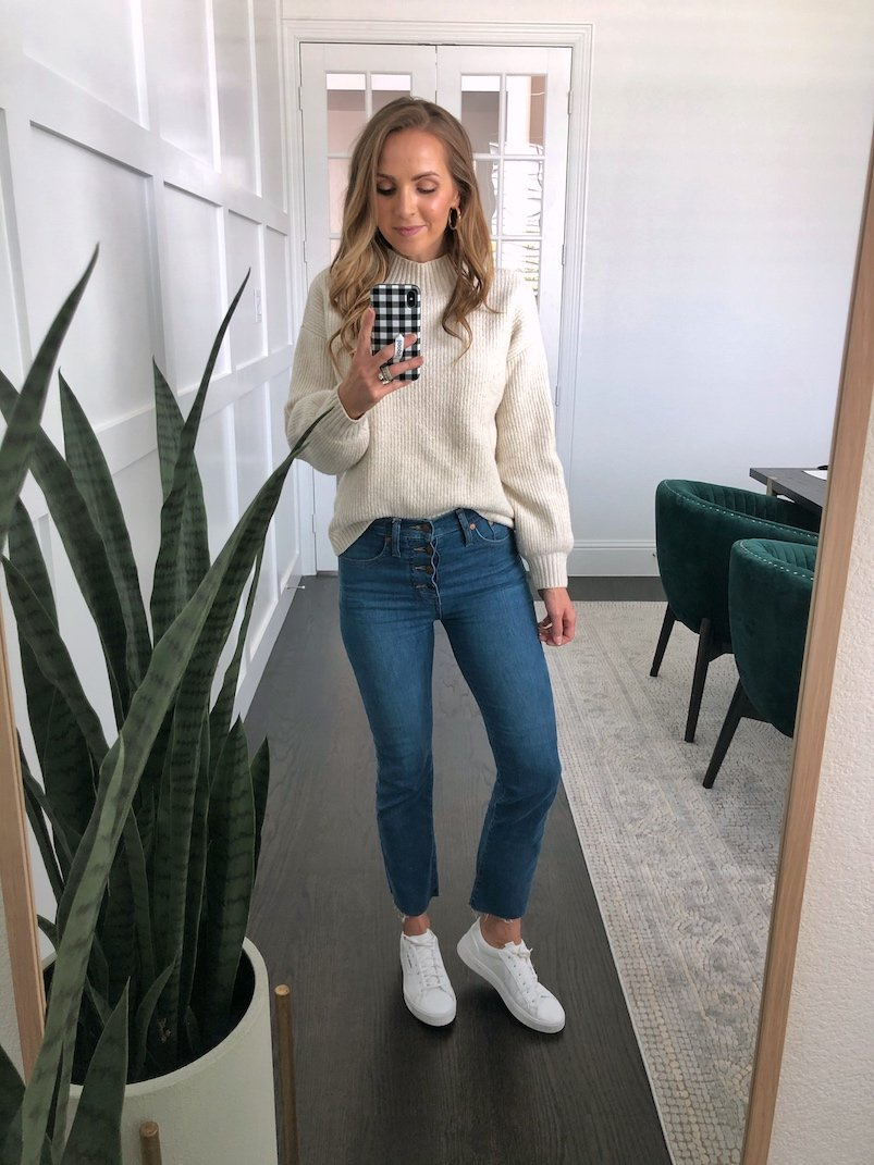 cream sweater with cropped flare jeans