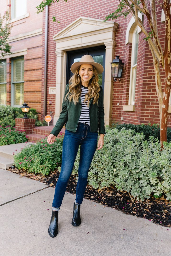 green suede jacket with striped t-shirt and felt fedora hat
